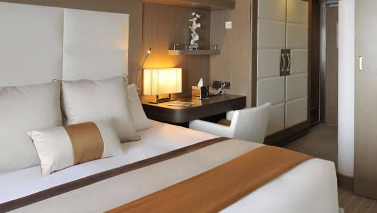 Superior Stateroom with king bed aboard L'Austral. Photo by: Ponant