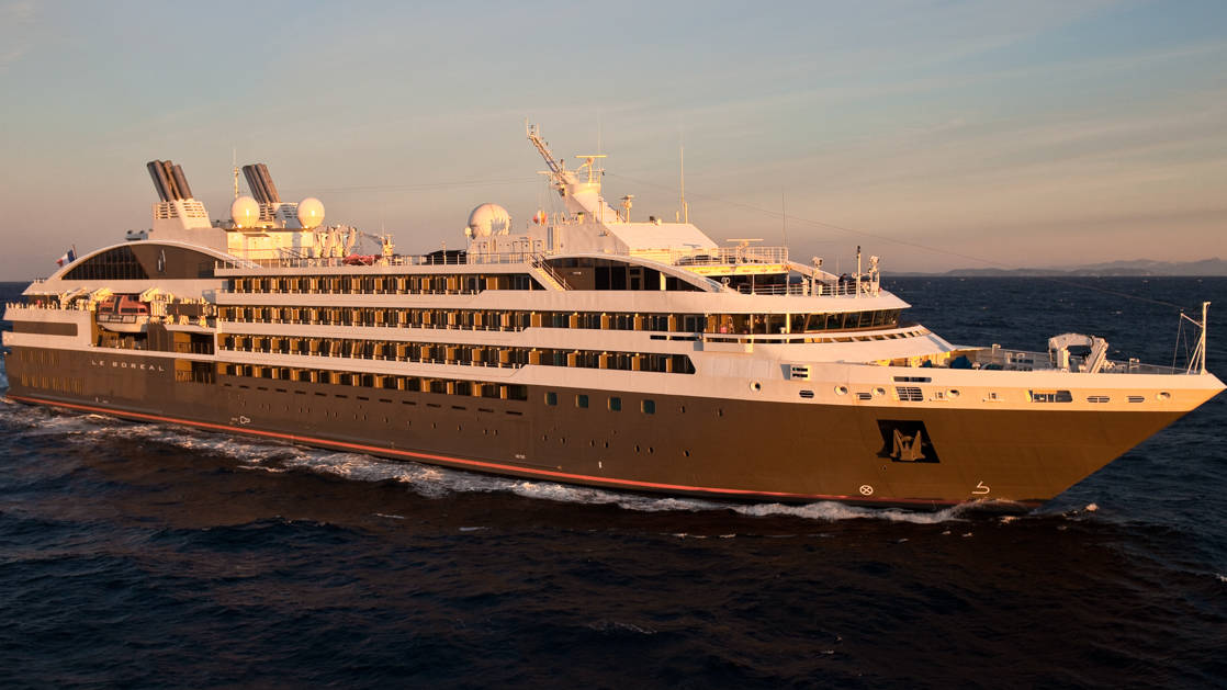 Exterior of expedition ship Le Boreal with 6 passenger decks & gray hull