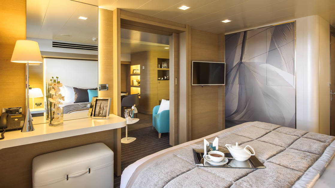 Owner's Suite with king bed aboard Le Soleal.  Photo by: Francois Lefebvre/Ponant