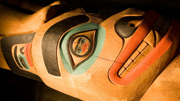 Detailed section of a totem pole as seen on the Ultimate Glacier Bay, Wilderness & Wildlife Alaska small ship cruise.