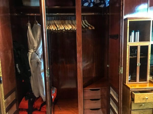 cabin storage closet aboard hebridean sky polar expedition ship, wooden closet with hangers a safe and life vets.