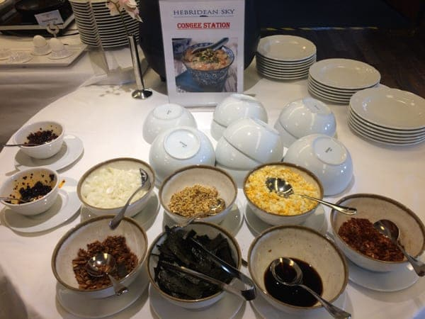 breakfast station aboard hebridean sky polar expedition ship  shows individual bowls of cereals, fruits, yogurt and more.