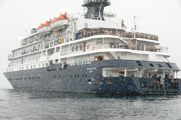 Exterior shot of the whte and blue painted polar expedition vessel the hebridean sky