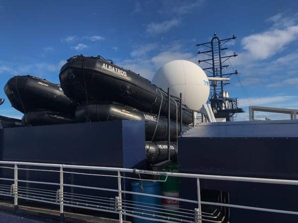 black inflatable zodiacs are shown stored on the upper deck of hebridean sky polar expedition ship