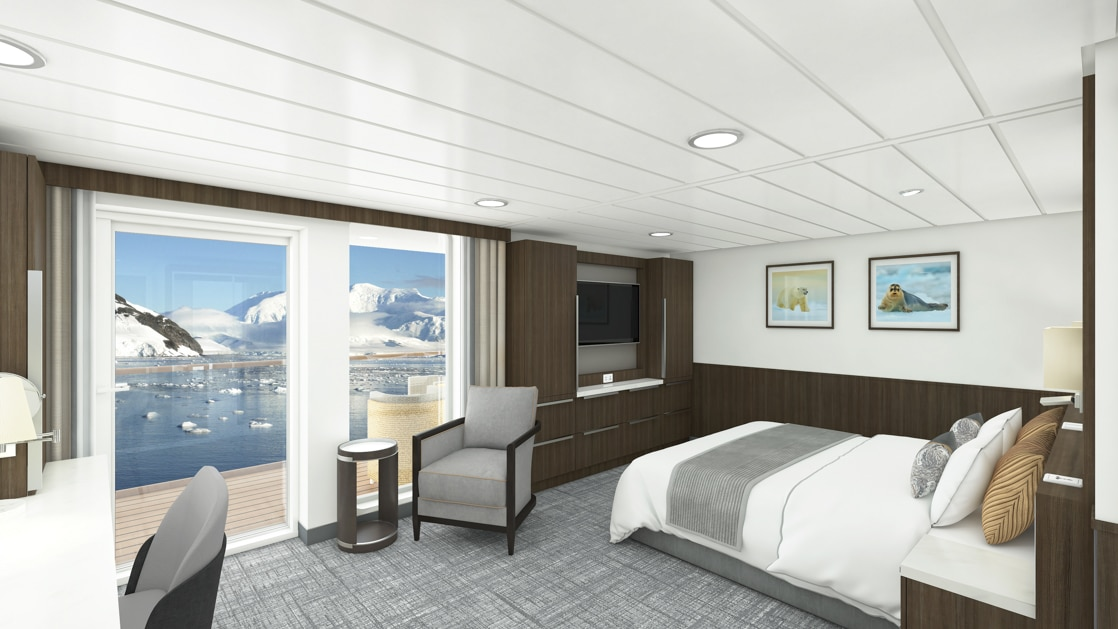 Superior Balcony Stateroom aboard Sylvia Earle polar ship, with a white-duvet-covered queen bed, chair at a desk, wardrobe, flatscreen tv & lounge chair next to sliding glass doors onto private balcony.