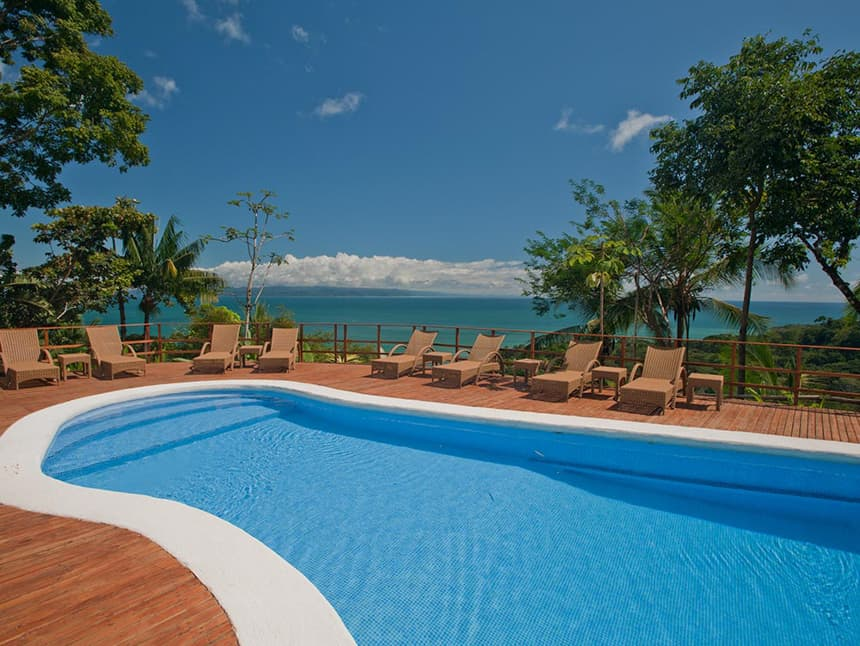 A view from the pool at Lapa Rios Eco Lodge Costa Rica, the crytal clear pool matches the blue sky and the ocean below it