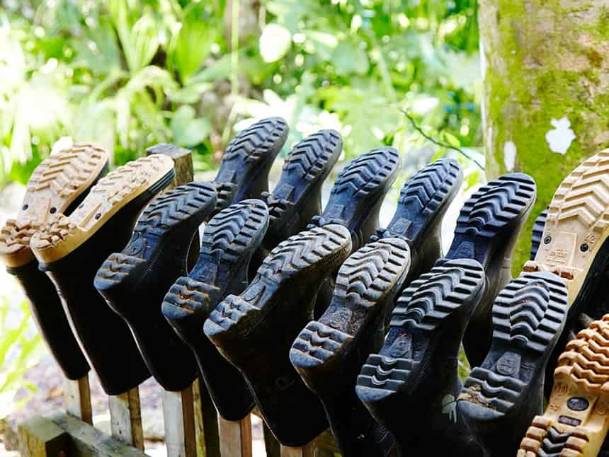 a row ot rubber boots hang to dry at the Lapa Rios Eco Lodge Costa Rica,
