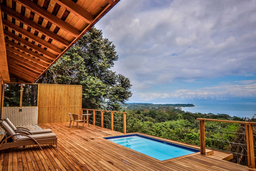 a view over lush jungle and to the ocean from Lapa Rios Eco Lodge Costa Rica