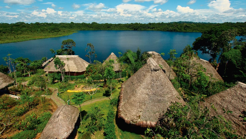an aerial view from above the cabanas at Napo wilflife center that sit lakefront in the Ecuadorian amazon
