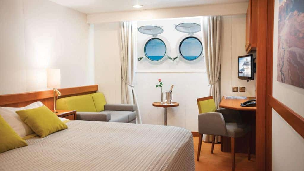 Porthole Stateroom with queen bed aboard Seaventure