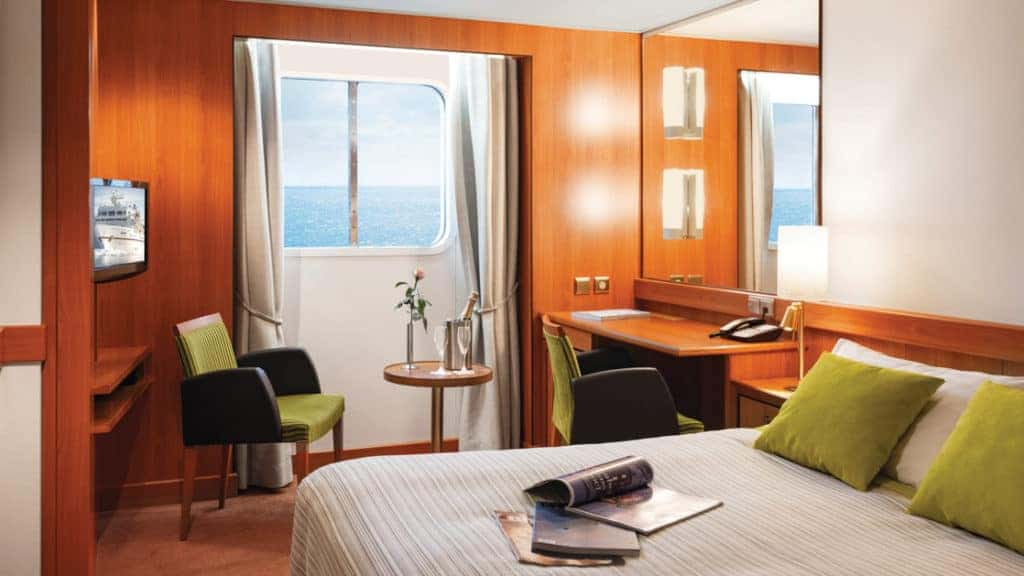 Window Stateroom with queen bed aboard Seaventure