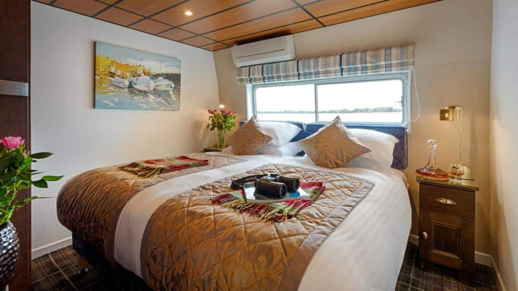 Suite with double bed aboard Shannon Princess. Photo by: Corin Bishop