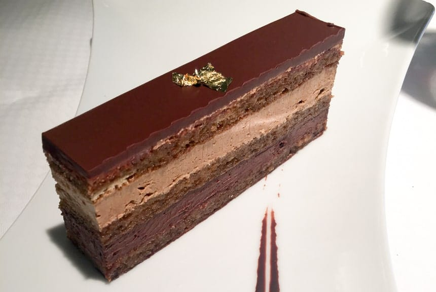 A piece of multi layered chocolate cake, served aboard Luxury small ship.