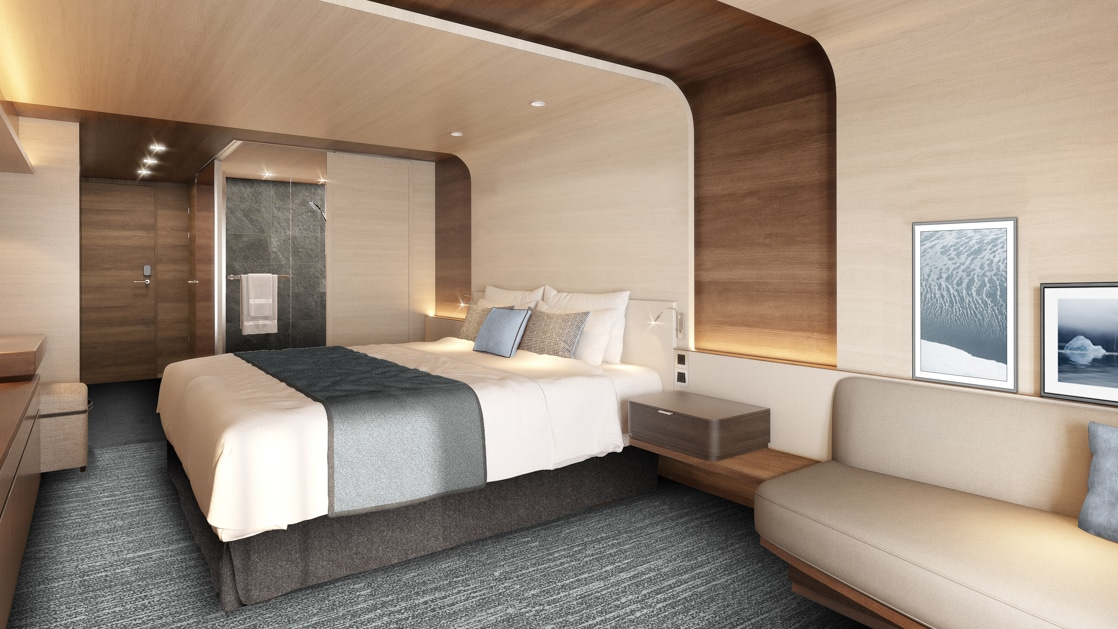 Rendering of cabin aboard Le Commandant Charcot ship, with beige & blue color theme, double bed, couch & bathroom.