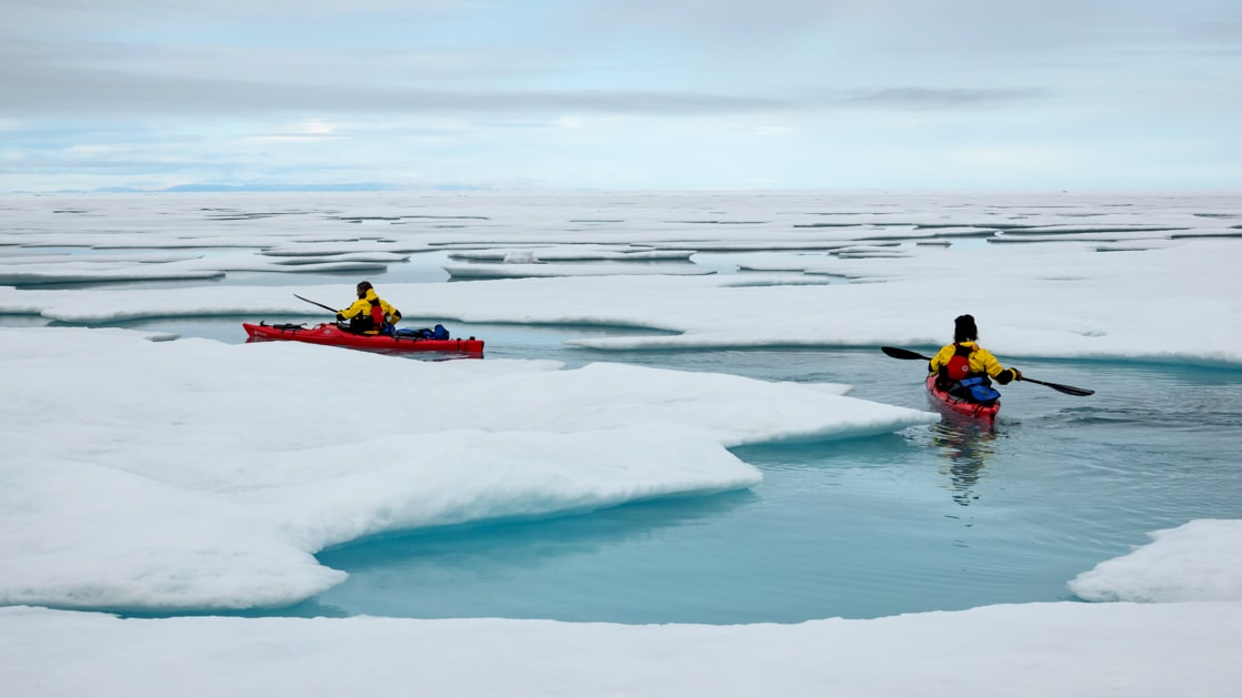 2 kayakers paddle between ice floes on Le Commandant Charcot Weddell Sea Voyages.