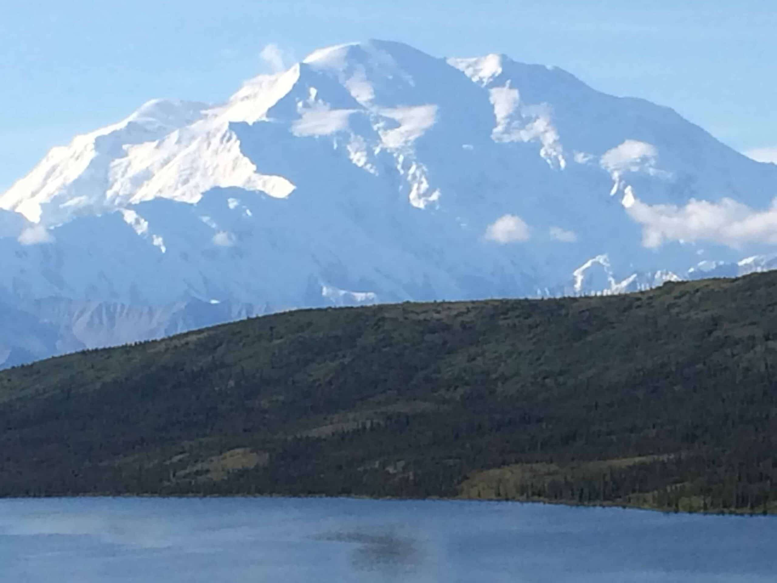 Snow-covered Denali mountain on a beautiful sunny day.