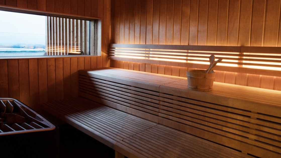 Inside of wooden sauna with under-bench lighting & view window at the Fosshotel Myvatn.