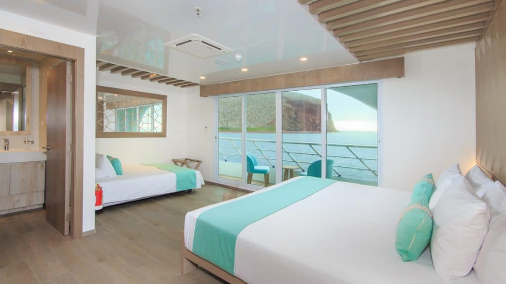 Golden Suite with king-size matrimonial bed and accommodation for a third guest aboard Endemic