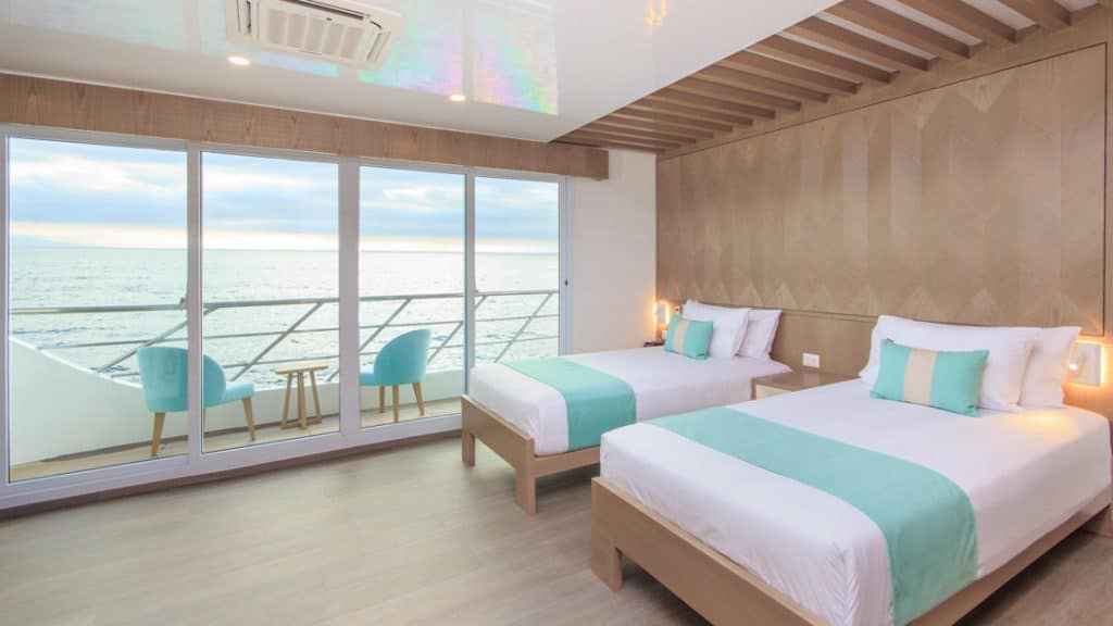 Golden Suite with twin beds aboard Endemic