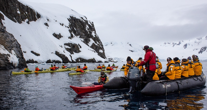 Quark expeditions, a top Antarctica cruise line begins their daily activity excursions, with guests enjoying a zodiac ride and kayaking.