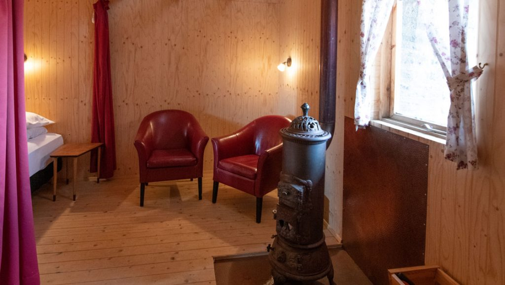 Downstairs double bed and seating area in traditional turf guesthouse