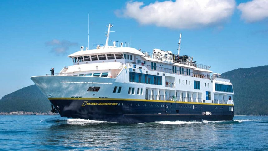 Full exterior of port side and bow of National Geographic Quest luxury expedition ship