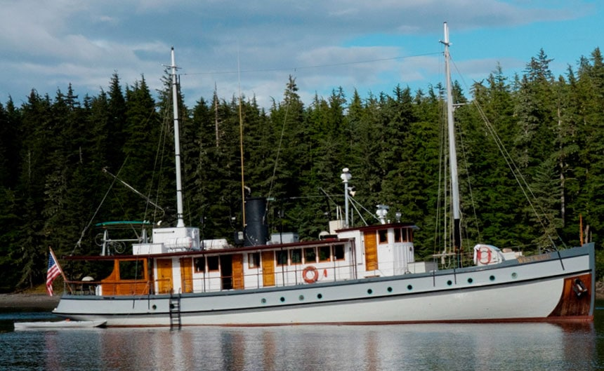 Westward exterior picture of starboard side with pine trees in background