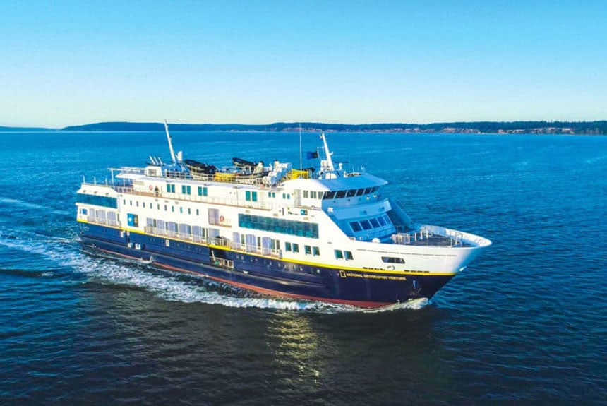 Exterior shot of National Geographic Venture ship in the open sea.